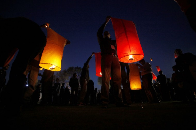 People launch sky lanterns during a ceremony to raise awareness about AIDS on the eve of World AIDS Day in Lahore, Pakistan on November 30, 2013. World AIDS Day is observed annually on December 1. (Mohsin Raza/Reuters)