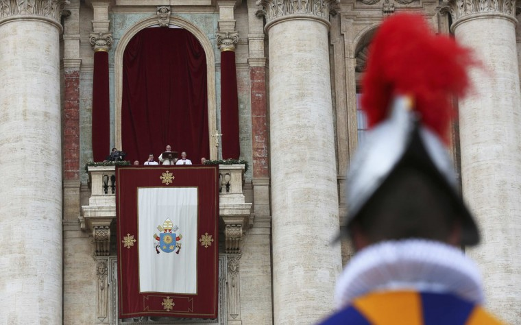 "A Swiss Guard stands as Pope Francis delivers his first ""Urbi et Orbi"" (to the city and world) message from the balcony overlooking St. Peter's Square at the Vatican December 25, 2013. (Alessandro Bianchi/Reuters)"