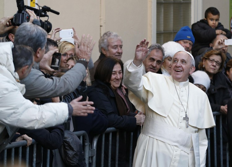 Pope Francis greets the crowd as he arrives for a visit at the Bambino Gesu Pediatric Hospital in Rome December 21, 2013. (REUTERSAlessandro Bianchi)