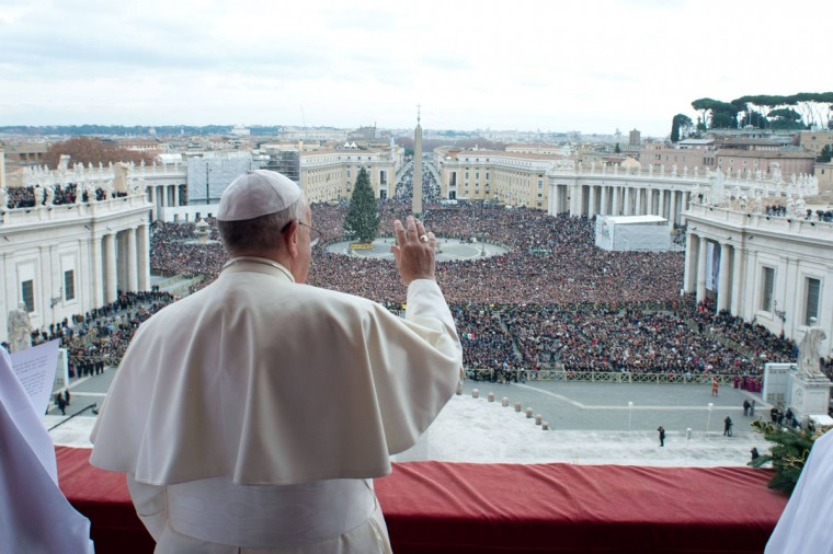 """Pope Francis waves as he delivers his first """"Urbi et Orbi"""" (to the city and world) message from the balcony overlooking St. Peter's Square at the Vatican December 25, 2013. Francis, celebrating his first Christmas as Roman Catholic leader, on Wednesday called for dialogue to end the conflict in South Sudan and all wars, saying everyone should strive to be personal peacemakers. (Osservatore Romano/Reuters)"""