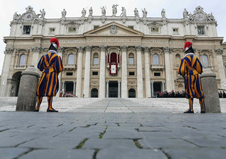 """Two Swiss Guards stand as Pope Francis delivers his first """"Urbi et Orbi"""" (to the city and world) address from the balcony overlooking St. Peter's Square at the Vatican December 25, 2013. (Alessandro Bianchi/Reuters)"""