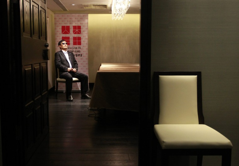 Chinese dissident Chen Guangcheng prepares himself before an interview with Reuters in Taipei June 24, 2013. (Pichi Chuang/Reuters)