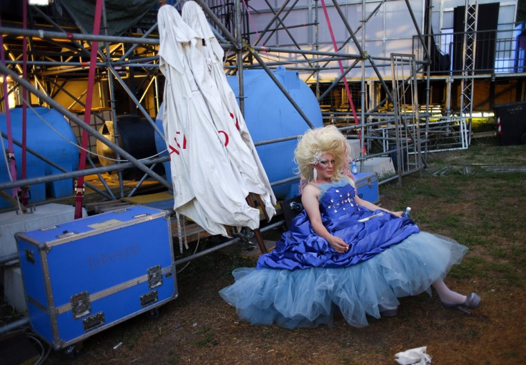 """A man relaxes in costume before a drag queen contest in Rome July 5, 2013. Following selections that began in January, drag queens from all over Italy have gathered in Rome to compete in the final of """"Drag Factor: The Italian Race"""", a contest inspired by the X-Factor format. (Max Rossi/Reuters)"""
