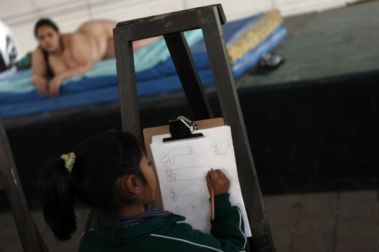 A model poses nude while a girl draws her during an art workshop on Valentine's Day in Mexico City February 14, 2013. (Edgard Garrido/Reuters)