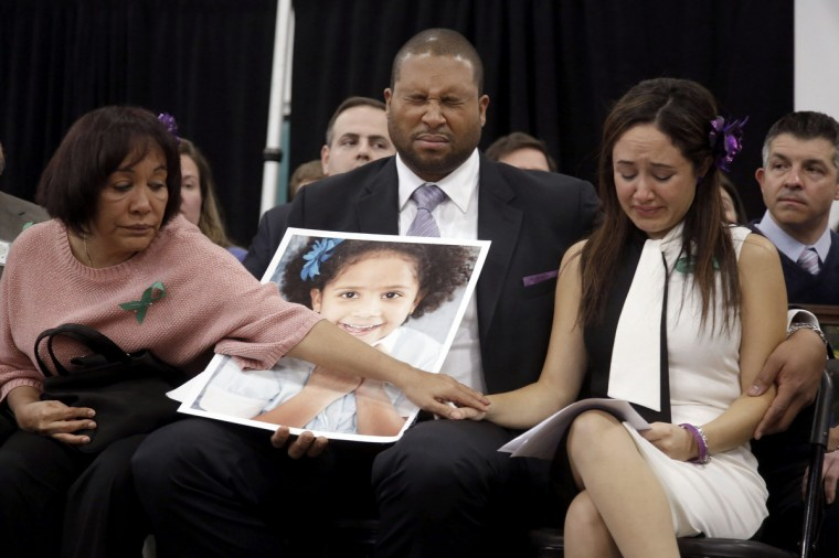 Nelba Marquez Greene (R), her husband Jimmy Greene and her mother Elba Marquez (L), grieve over the loss of the Greenes' daughter Ana Grace Marquez Greene (in photo) at the launch of the Sandy Hook Promise in Newtown, Connecticut January 14, 2013. (Gary He/Insider Images/Reuters)