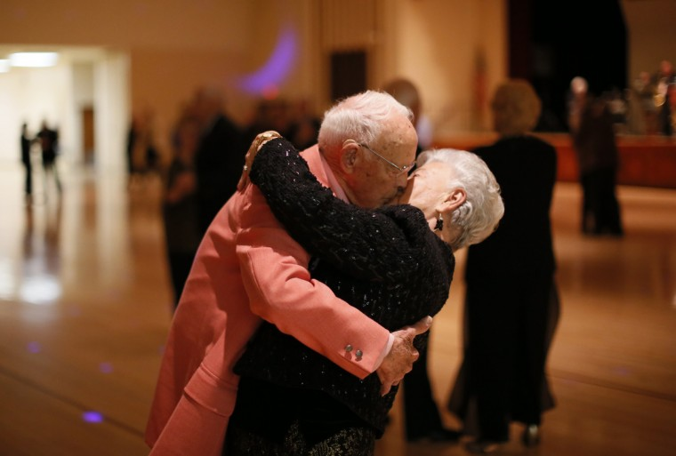 Donald Smitherman, 98, kisses his wife Marlene at the end of a dance in Sun City, Arizona, January 5, 2013. Sun City was built in 1959 by entrepreneur Del Webb as America's first active retirement community for the over-55s. Webb predicted that retirees would flock to a community where they were given more than just a house with a rocking chair in which to sit and wait to die. Today's residents keep their minds and bodies active by socializing at over 120 clubs with activities such as square dancing, ceramics, roller skating, computers, cheerleading, racquetball and yoga. There are 38,500 residents in the community with an average age of 72.4 years. (Lucy Nicholson/Reuters)