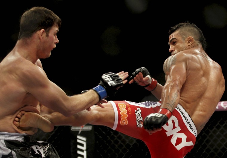 Vitor Belfort (R) of Brazil fights Michael Bisping of Britain during the Ultimate Fighting Championship (UFC), a professional mixed martial arts (MMA) competition, in Sao Paulo January 20, 2013. (Paulo Whitaker/Reuters)