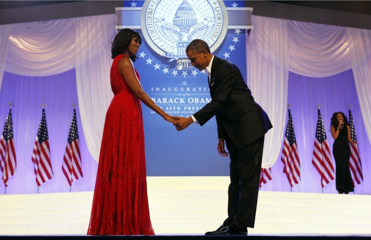 U.S. President Barack Obama bows to first lady Michelle Obama, as singer Jennifer Hudson (R) performs behind them, at the Inaugural Ball in Washington, January 21, 2013. (Kevin Lamarque/Reuters)