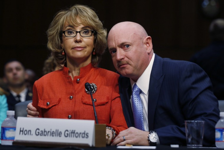 Former U.S. Representative Gabrielle Giffords (L) delivers her opening remarks while seated next to her husband, former U.S. Navy Captain Mark Kelly, during a hearing held by the Senate Judiciary committee about guns and violence on Capitol Hill in Washington, January 30, 2013. (Larry Downing/Reuters)