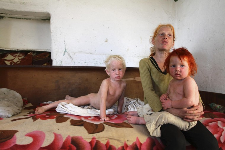 """The children of Roma woman Sasha Ruseva, 38, (not pictured) rest inside their home in Nikolaevo, southern Bulgaria October 24, 2013. Ruseva, believed to have given birth in a hospital in central Greece in January 2009 to the blonde girl named Maria, found during a police sweep in a Roma settlement in central Greece on October 16, was questioned by Bulgarian police, state television said on Thursday. """"I do not know whether she is mine or not. We had a child. We left it in Greece as I had nothing to feed her,"""" Ruseva told reporters. """"I did not take any money. My daughter left with a man, so there was no one to look after the other children."""" (Reuters)"""