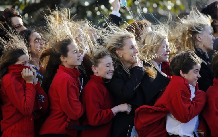 Sixth grade students from the Park Maitland School in Maitland, Florida, watch as Marine One carrying U.S. President Barack Obama to Las Vegas takes off from the South Lawn at the White House in Washington, January 29, 2013. (Larry Downing/Reuters)