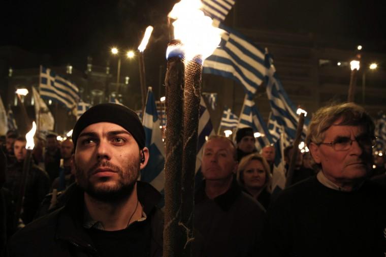 Supporters of the extreme-right Golden Dawn party hold torches during a gathering in Athens February 2, 2013. Thousands of supporters gathered to pay tribute to three Greek officers who were killed in 1996 when their helicopter crashed over the eastern Aegean isle of Imia during a crisis with Turkey. (Yorgos Karahalis/Reuters)