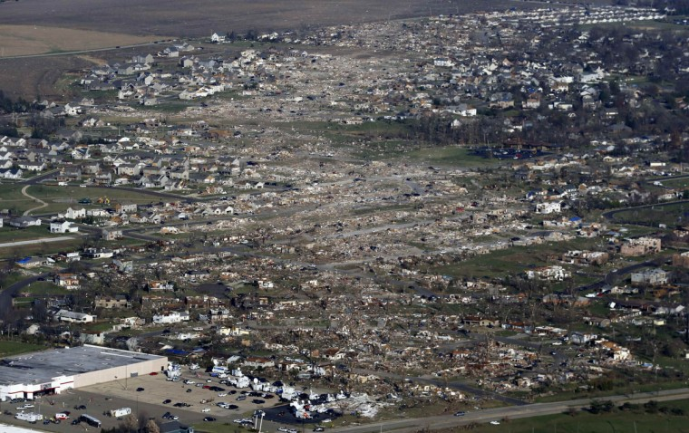 An aerial view shows the path of destruction caused by a tornado that touched down in Washington, Illinois, November 18, 2013. A fast-moving storm system triggered multiple tornadoes that killed at least six people and flattened large parts of a town in Illinois as it tore across the Midwest, authorities said. (Jim Young/Reuters)