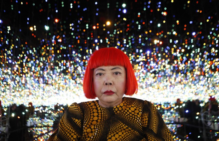 "Japanese artist Yayoi Kusama poses for a photograph inside her Infinity Mirrored Room installation titled ""The Souls of Millions of Light Years Away"" during a media preview of her new exhibition at the David Zwirner gallery in New York November 7, 2013. The exhibition, titled ""I Who Have Arrived in Heaven"", features two mirrored rooms, a video installation and over 30 new large-scale paintings highlighting her unique amalgamation of representational and non-representational subject matter. The exhibition ran from November 8 to December 21. (Mike Segar/Reuters)"