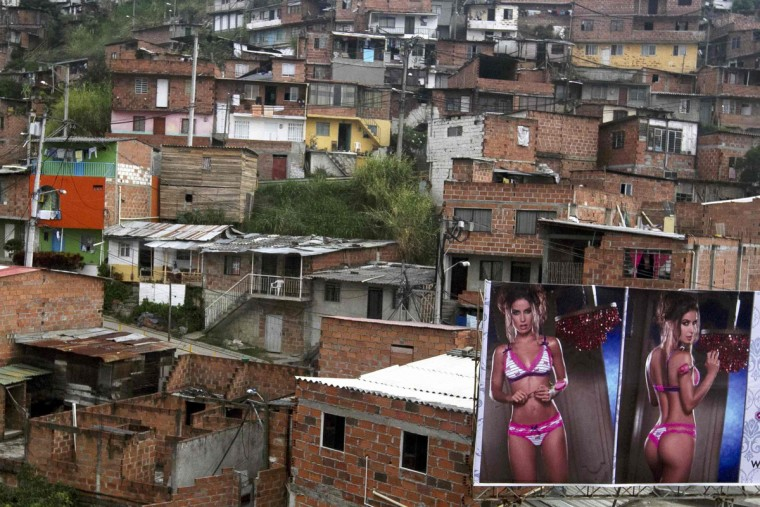 A billboard with pictures of a lingerie model is seen in front of the Commune, northwest of Medellin city March 12, 2013. (Albeiro Lopera/Reuters)