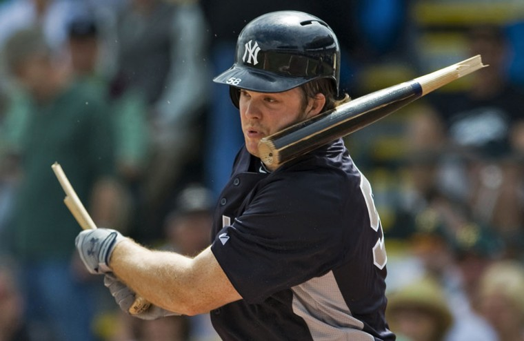 The barrel of New York Yankees Brennan Boesch's broken bat smacks his face during the first inning of a MLB spring training baseball game against the Pittsburgh Pirates in Bradenton, Florida, March 17, 2013. (Steve Nesius/Reuters)