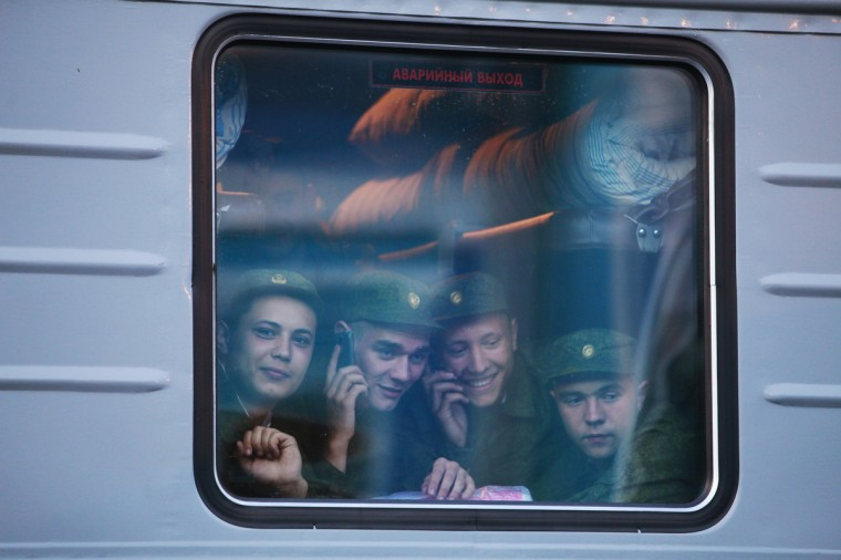 Russian conscripts, wearing military uniforms, are seen inside a train carriage at a local railway station before their departure in Stavropol, in southern Russia, May 15, 2013. The conscripts will serve in Moscow in the Kremlin regiment, also known as Presidential regiment, which is part of the Federal Guard Service. (Eduard Korniyenko/Reuters)