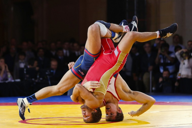 Russia's Saba Khubetzhty (L) and David Taylor of the U.S. flip over on their heads during the Rumble on the Rails wrestling event held inside the Grand Central Terminal in New York May 15, 2013. (Lucas Jackson/Reuters)