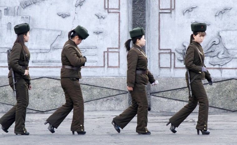 Female North Korean soldiers patrol along the banks of Yalu River, near the North Korean town of Sinuiju, opposite the Chinese border city of Dandong, April 11, 2013. South Korea and the United States were on high alert for a North Korean missile launch as the hermit kingdom turned its attention to celebrating its ruling Kim dynasty and appeared to tone down rhetoric of impending war. (Jacky Chen/Reuters)