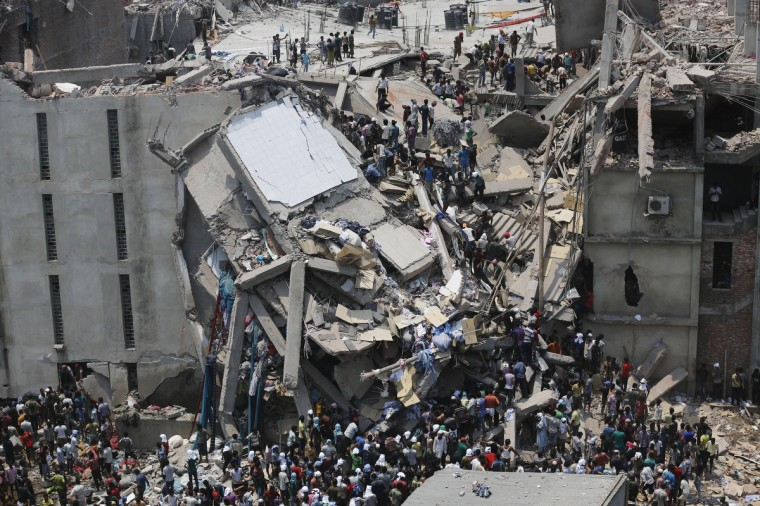 People rescue garment workers trapped under rubble at the Rana Plaza building after it collapsed, in Savar, 30 km (19 miles) outside Dhaka April 24, 2013. An eight-storey block housing garment factories and a shopping centre collapsed on the outskirts of the Bangladeshi capital, killing at least 25 people and injuring more than 500, the Ntv television news channel reported. (Andrew Biraj/Reuters)