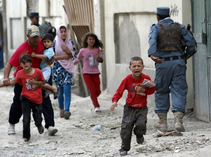 Children run away after an explosion in Kabul May 24, 2013. Several large explosions rocked a busy area in the centre of the Afghan capital, Kabul, with Reuters witnesses describing shooting in the area. (Omar Sobhani/Reuters)