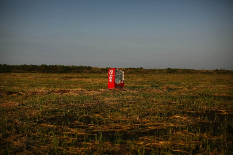 A vending machine, brought inland by a tsunami, is seen in an abandoned rice field inside the exclusion zone at the coastal area near Minamisoma in Fukushima prefecture September 21, 2013. In 2011 a massive earthquake and tsunami wrecked the Fukushima nuclear plant, resulting in a meltdown that became the world's worst atomic crisis in 25 years. About 160,000 people living near the plant were ordered to move out and the government established a 20-km compulsory evacuation zone. The operator of the plant, Tokyo Electric Power Co, is struggling to contain contaminated water at the site 240 km (149 miles) north of Tokyo. There have been multiple leaks and glitches over the last two and a half years. (Damir Sagolj/Reuters)