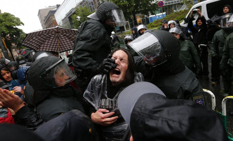 "German riot police scuffle with protestors in front of the European Central Bank (ECB) head quarters during a anti-capitalism ""Blockupy"" demonstration in Frankfurt, May 31, 2013. Several thousand people take part in demonstrations against capitalism and austerity. (Kai Pfaffenbach/Reuters)"