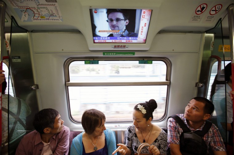 Passengers watch a television screen broadcasting news on Edward Snowden, a contractor at the National Security Agency (NSA) of the U.S., on a train in Hong Kong June 14, 2013. Federal Bureau of Investigation (FBI) Director Robert Mueller has said that the U.S. government is doing everything it can to hold confessed leaker Snowden accountable for splashing surveillance secrets across the pages of newspapers worldwide. (Bobby Yip/Reuters)