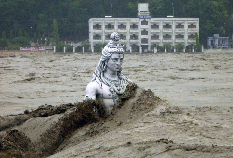 A submerged statue of the Hindu Lord Shiva stands amid the floodwaters of the Ganges river at Rishikesh in the Himalayan state of Uttarakhand June 17, 2013. Early monsoon rains have swollen the Ganges, India's longest river, swept away houses, killed at least 60 people and left tens of thousands stranded, officials said on June 18, 2013. (Reuters)