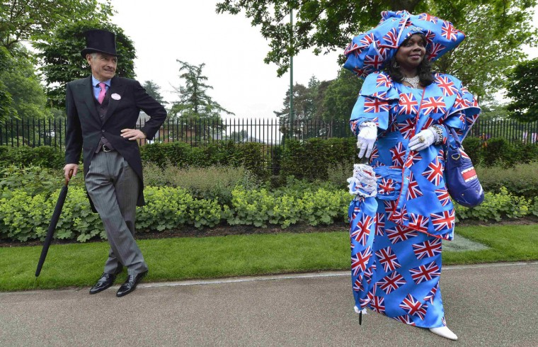 A racegoer wearing a Union flag-inspired outfit arrives for Ladies' Day at the Royal Ascot horse-racing festival at Ascot, southern England June 20, 2013. (Toby Melville/Reuters)