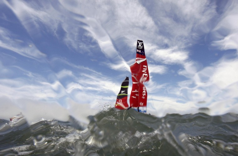 The Team Emirates New Zealand sails before the third race of their Louis Vuitton Cup challenger series yacht race against Luna Rossa Challenge in this underwater picture in San Francisco, California August 18, 2013. (Peter Andrews/Reuters)