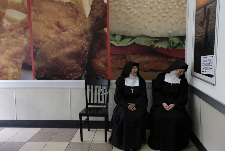 Nuns sit at a fast food restaurant downtown of Guatemala City August 28, 2013. (Jorge Dan Lopez/Reuters)