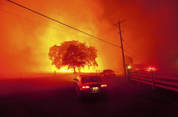Residents flee as winds whip flames from the Morgan fire along Morgan Territory Road near Clayton, California in unincorporated Contra Costa County September 9, 2013. The blaze, burning in dense, dry scrub, grass and timber in and around Mount Diablo State Park, had scorched some 3,700 acres (1,500 hectares) by Monday afternoon, forcing the evacuation of about 100 homes at the edge of the town of Clayton. (Noah Berger/Reuters)