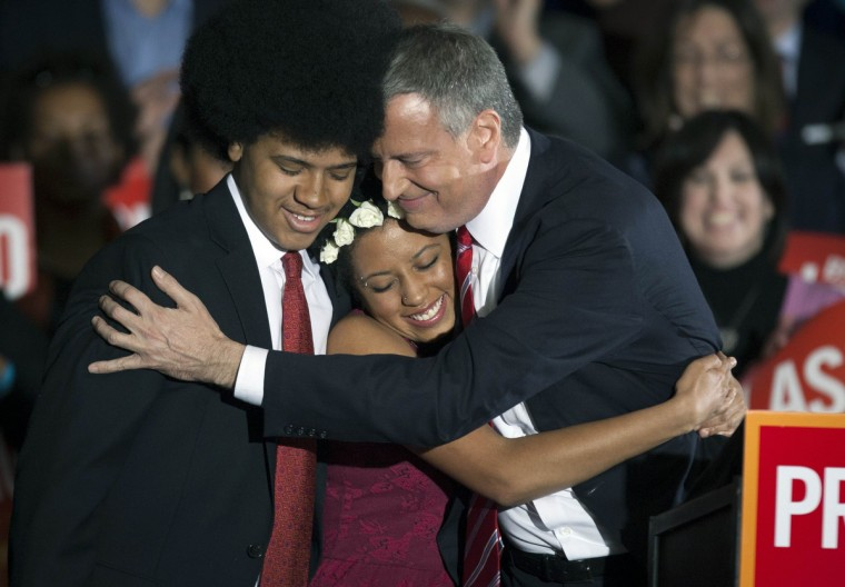 Democratic mayor-elect of New York, Bill de Blasio, hugs his daughter Chiara and son Dante during his election victory party at the Park Slope Armory in New York, November 5, 2013. (Carlo Allegri/Reuters)