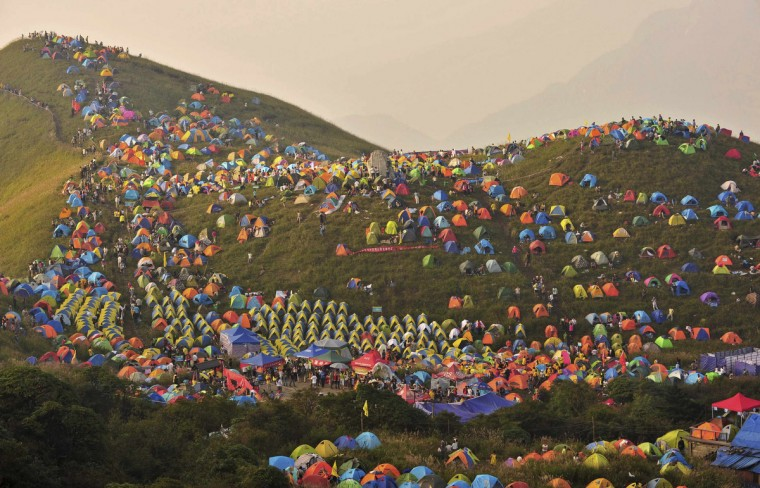 Numerous tents are seen during the 2013 International I Camping Festival in Mount Wugongshan of Pingxiang, Jiangxi province, September 14, 2013. The event which opened on September 14 attracted more than 15,000 campers all over the world, according to Xinhua News Agency. (Reuters)