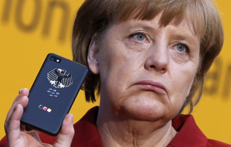 German Chancellor Angela Merkel holds a BlackBerry Z10 smartphone featuring high security Secusite software, used for governmental communication, at the booth of Secusmart during her opening tour at the CeBit computer fair in Hanover March 5, 2013. (Fabrizio Bensch/Reuters)