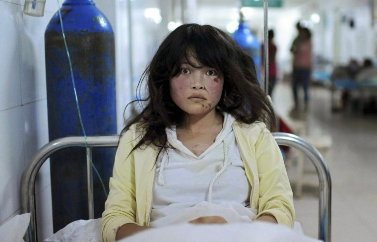 Song Xuxia, 19, receives treatment at a hospital after a 6.6 magnitude earthquake hit Minxian county, Dingxi, Gansu province July 23, 2013. The death toll from two earthquakes in China's western Gansu province has climbed to 95, with more than 1000 people injured, after around 51,800 buildings collapsed and tens of thousands more were badly damaged. Song's leg, waist and face were injured during the earthquake when she was stuck in a collapsed house. Fortunately the villagers heard her cry and managed to pull her out from the debris in time, according to local media. (Reuters)