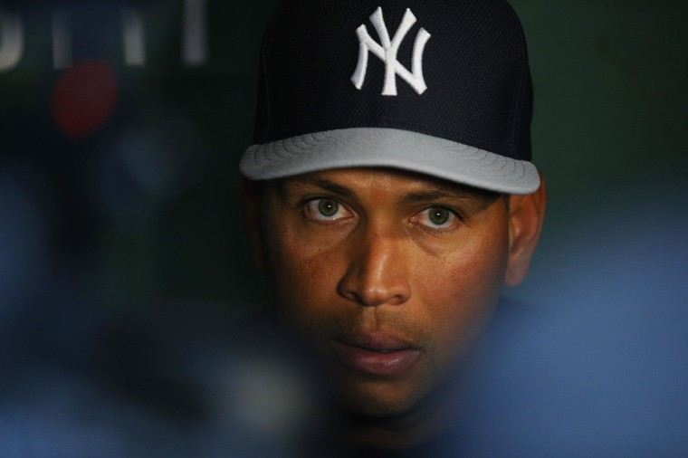 New York Yankees third baseman Alex Rodriguez talks to reporters in the visitors dugout before the Yankees' American League baseball game against the Boston Red Sox at Fenway Park in Boston, Massachusetts August 16, 2013. (Brian Snyder/Reuters)