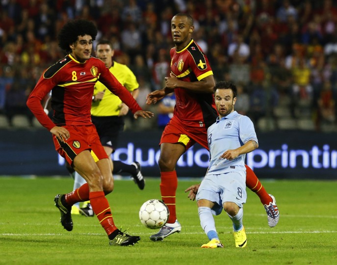 France's Mathieu Valbuena (R) is challenged by Belgium's Marouane Fellaini (L) and Vincent Kompany (C) during their international friendly soccer match at the King Baudouin stadium in Brussels August 14, 2013. (Yves Herman/Reuters)