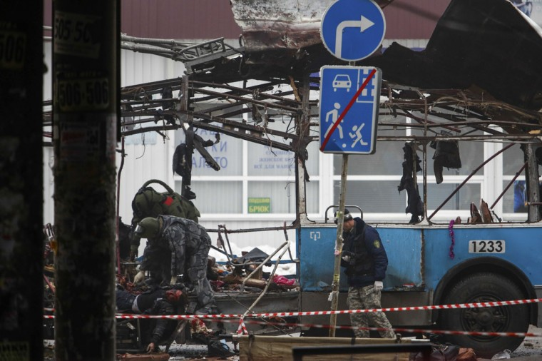 Members of the emergency services work at the site of a blast on a trolley bus in Volgograd on December 30, 2013. (REUTERS / Sergei Karpov)