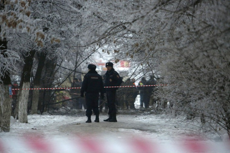 Police stand guard at the site of a blast on a trolley bus in Volgograd on December 30, 2013. Russian President Vladimir Putin on Monday ordered law enforcement agencies to increase security in the southern city of Volgograd and nationwide after two deadly bombings in Volgograd, the Kremlin said. (REUTERS / Sergei Karpov )
