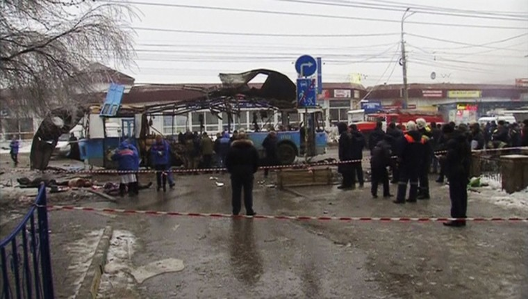 A still image taken from video shows members of the emergency services working at the site of a blast on a trolley bus in Volgograd. (Reuters photo)