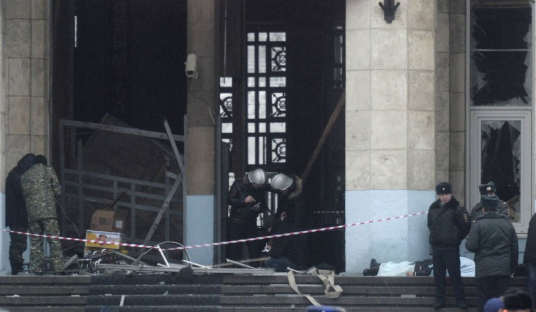 Investigators work at the site of an explosion at the entrance of a train station in Volgograd. A female suicide bomber blew herself up in the entrance hall of a Russian train station on Sunday, killing at least 14 people in the second deadly attack within three days as the country prepares to host the Winter Olympics. (REUTERS / Sergei Karpov)