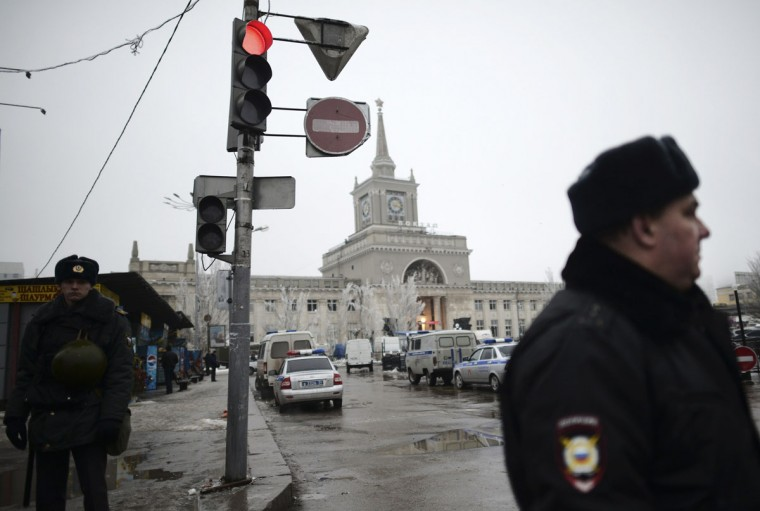 Interior Ministry members stand guard in front of the train station where a bomber detonated explosives in Volgograd on December 29, 2013. A female suicide bomber blew herself up in the entrance hall of a Russian train station on Sunday, killing at least 14 people in the second deadly attack within three days as the country prepares to host the Winter Olympics. (REUTERS / Sergei Karpov)