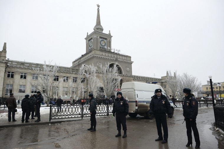 Policemen block the way to a train station after an explosion in Volgograd on December 29, 2013. A female suicide bomber blew herself up in the entrance hall of the Russian train station on Sunday, killing at least 13 people in the second deadly attack in the space of three days as the country prepares to host the Winter Olympics. (REUTERS / Sergei Karpov)
