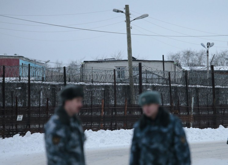 Police officers guard the road in front of the Penal Colony 7, where Mikhail Khodorkovsky was held at the village of Segezha, near the Finnish border, 300 km (186 miles) south of the Arctic Circle, December 20, 2013. Khodorkovsky, once Russia's richest man, left prison on Friday after a pardon from President Vladimir Putin ended a decade in jail that many saw as the fallen oil tycoon's punishment for daring to challenge the Kremlin. (REUTERS/Tatyana Makeyeva)