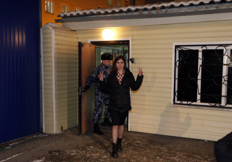 Pussy Riot member Nadezhda Tolokonnikova gestures as she walks out of prison in Krasnoyarsk, December 23, 2013. Tolokonnikova was freed from prison on Monday under an amnesty that allowed for her early release from a two-year sentence for a protest in a church against President Vladimir Putin. (Ilya Naymushin /Reuters)
