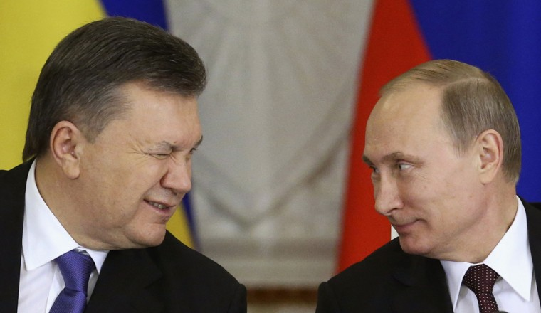 Ukrainian President Viktor Yanukovich (L) gives a wink to his Russian counterpart Vladimir Putin during a signing ceremony after a meeting of the Russian-Ukrainian Interstate Commission at the Kremlin in Moscow, December 17, 2013. Russia is planning to buy $15 billion worth of Ukraine's upcoming eurobonds using money from a sovereign wealth fund this year and next, Russian Finance Minister Anton Siluanov said on Tuesday. (Sergei Karpukhin/Reuters)