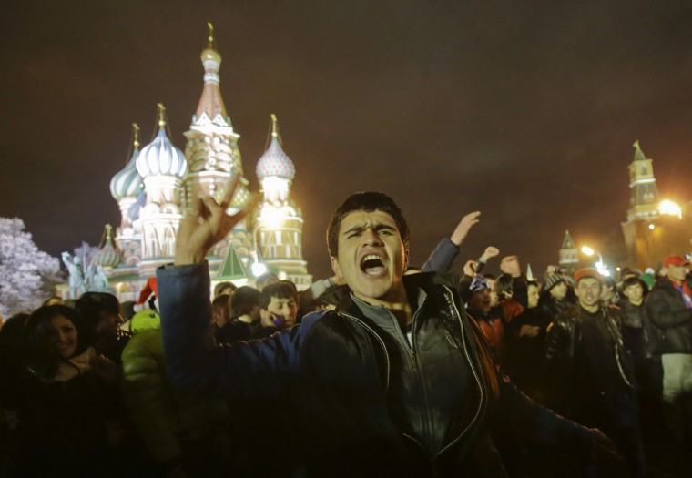 Revelers enjoy the countdown to the New Year celebrations in Moscow's Red Square December 31, 2013. (REUTERS/Tatyana Makeyeva)