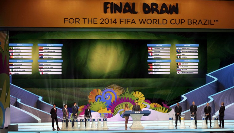 The groups for the 2014 World Cup finals are shown on the screen after the draw was made at the Costa do Sauipe resort in Sao Joao da Mata, Bahia state, December 6, 2013. The 2014 World Cup finals will be held in Brazil from June 12 through July 13. (REUTERS/Sergio Moraes)